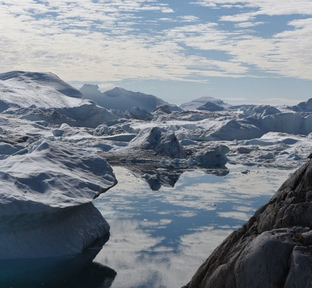 Hike the Ilulissat Icefjord by taking the Green Trail to Sermermiut then following the Blue Trail, Greenland; Christine Connell; Outbound Collective